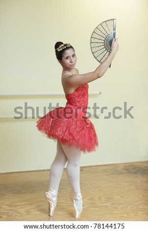 Ballerina with a hand fan - stock photo
