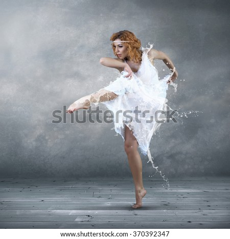 Ballerina with dress of milk - stock photo