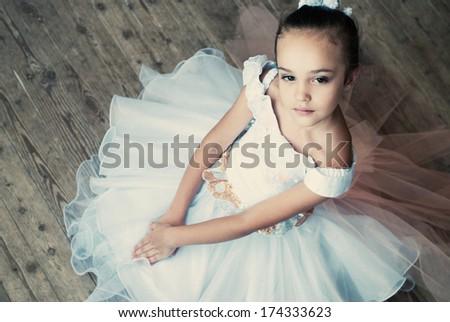 Ballet, ballerina - young and beautiful ballet dancer in tutu in dance studio. Art photo. - stock photo
