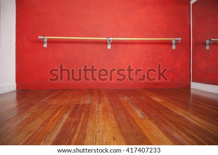 Ballet Bar Against Wall In Empty Studio - stock photo