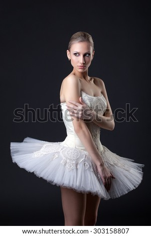 Ballet. Beautiful dancer posing in tutu - stock photo