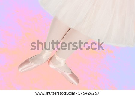 Ballet dancer standing on colorful floor while dancing in pink tutu artistic conversion - stock photo