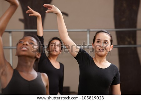 Ballet students rehearsing arm movements during practice - stock photo