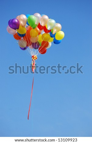 Ballons in the blue sky do happen occationally in sports event and launching ceremony. - stock photo