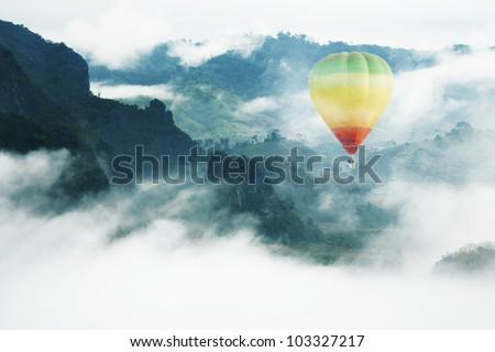 Balloon float in the mist , Balloon in the Paradise - stock photo