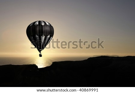 balloon flying into sunset over water - stock photo