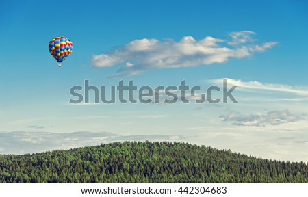 balloon flying over a beautiful landscape - stock photo