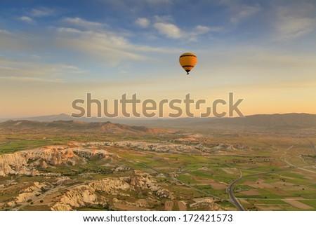 Balloon in Cappadocia over the hills - stock photo