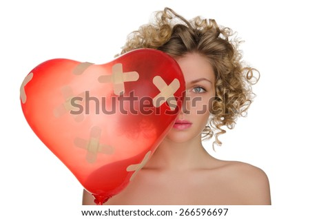 Balloon in shape of heart and hurt woman isolated on white - stock photo