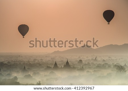 Balloon over pagodas with foggy morning in Bagan, Myanmar. Asia Travel Style. blurred image  - stock photo