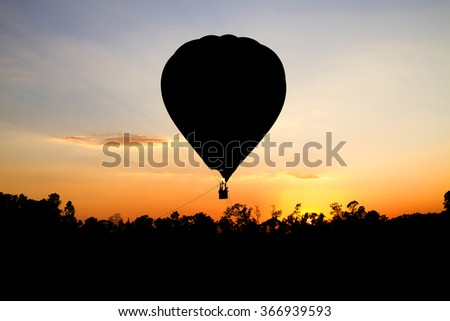 Balloon silhouette in the sunset - stock photo