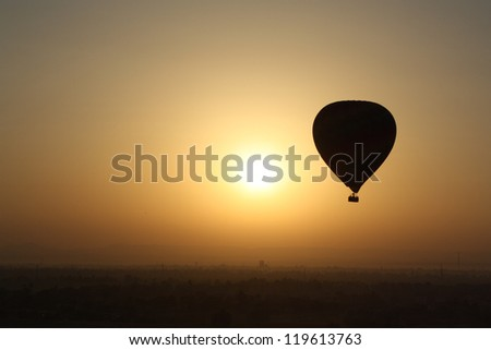 Balloon Silhouette over Valley of the Kings, Luxor, Egypt - stock photo