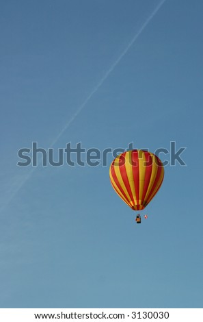 Balloon with danish flag in blue sky - stock photo
