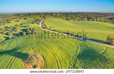 Ballooning over Israel - bird's eye view of farm lands and hills near Tel Aviv after the rain, seen from a hot air balloon - stock photo