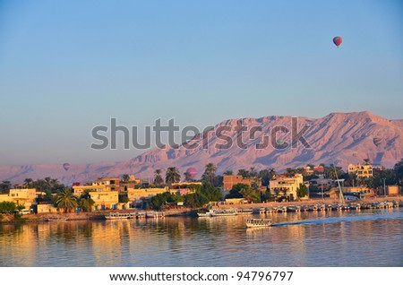 Balloons above Luxor, Egypt at dawn - stock photo