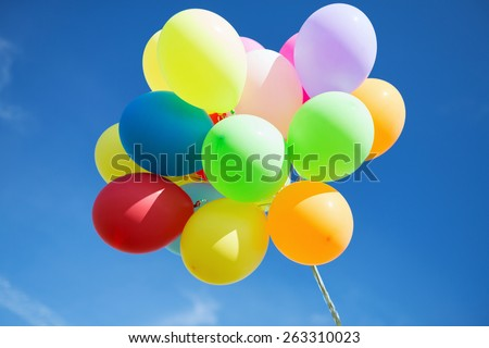 balloons and celebration concept - lots of colorful balloons in the sky - stock photo