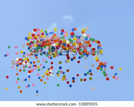 Balloons flying in the blue sky - stock photo