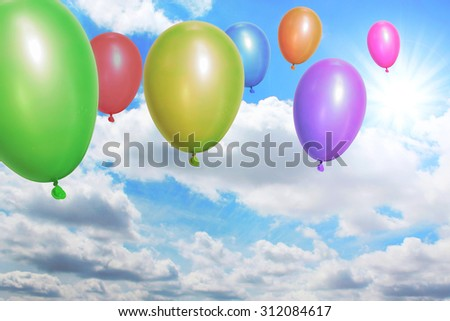 Balloons flying through the sky - stock photo