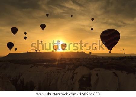 Balloons in Cappadocia at dawn sky background - stock photo