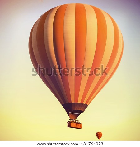 Balloons in the sky over Cappadocia at sunrise. Vintage retro style - stock photo