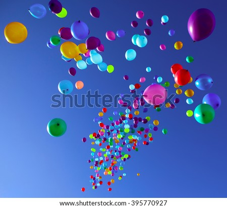 Balloons on a blue sky background - stock photo