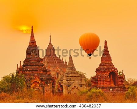 Balloons over Htilominlo Temple at sunrise in Bagan. Myanmar.  - stock photo