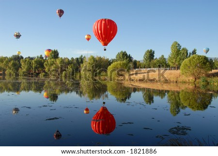 Balloons reflected in a lake, Reno, Nevada - stock photo