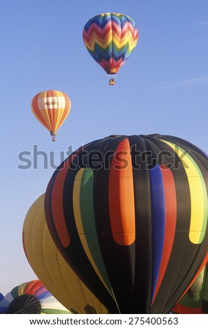 Balloons take to the air at the Albuquerque International Balloon Fiesta in New Mexico - stock photo