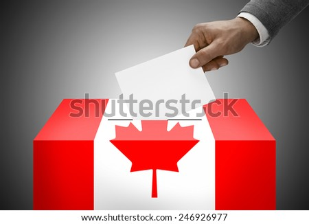 Ballot box painted into national flag colors - Canada - stock photo
