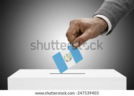 Ballot box painted into national flag colors - Guatemala - stock photo