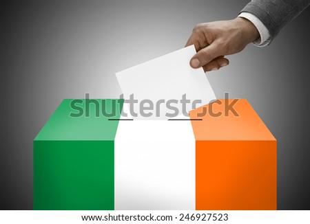 Ballot box painted into national flag colors - Ireland - stock photo
