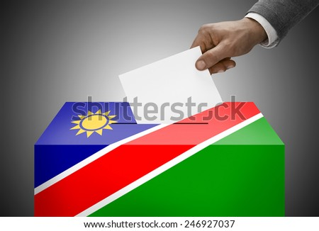 Ballot box painted into national flag colors - Namibia - stock photo