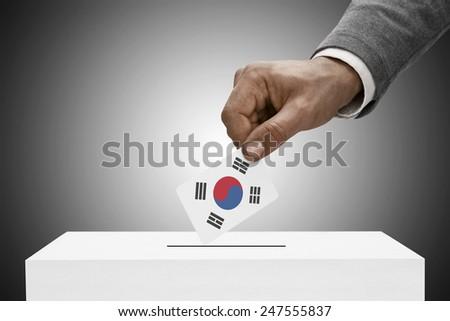 Ballot box painted into national flag colors - South Korea - stock photo