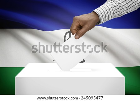 Ballot box with national flag on background - Lesotho - stock photo