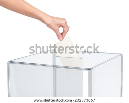 Ballot box with person casting vote on blank voting slip  - stock photo