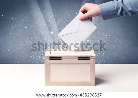 Ballot box with person casting vote on sparkling background - stock photo