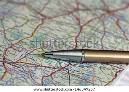 Ballpoint pen over road map of Finland. Shallow depth of field. - stock photo