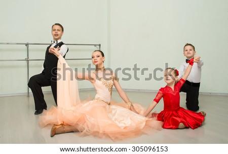 Ballroom dancing, group, man, woman, children, dance studio - stock photo