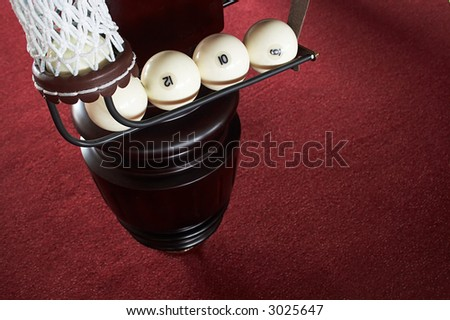 balls in a billiard pocket on a red background - stock photo