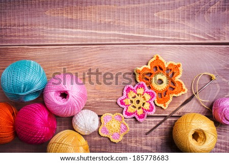 Balls of colored yarn on wooden boards - stock photo