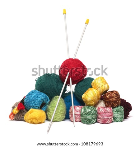 Balls of knitting wool with knitting needles - stock photo