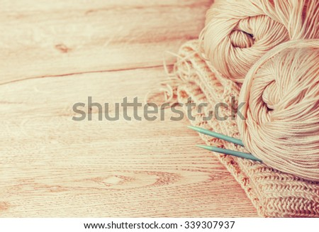 balls of yarn and knitting needles on knitting  with copyspace (Toning) - stock photo