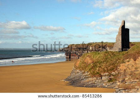 ballybunion castle on the cliffs in the west coast of ireland above a beautiful beach with horses - stock photo