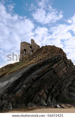 ballybunion castle on the rocks in the west coast of ireland - stock photo