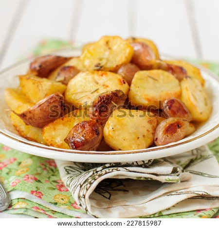 Balsamic Roast Potato with Unpeeled Garlic, Eschalot and Rosemary, square, copy space for your text - stock photo