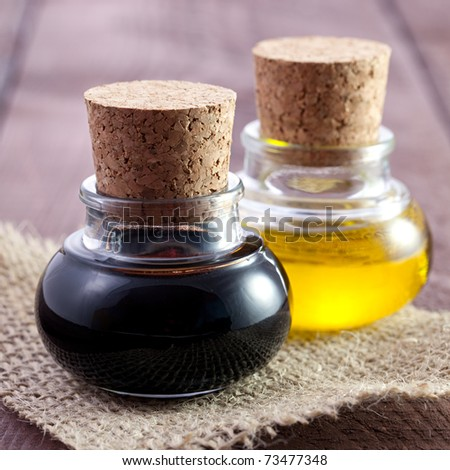 balsamic vinegar and oil in bottles - stock photo