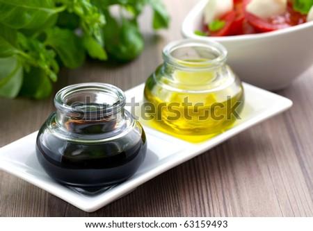 balsamic vinegar and olive oil in two glasses - stock photo