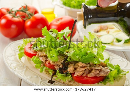 balsamic vinegar over tuna salad  - stock photo