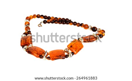 Baltic amber necklace isolated on white - stock photo