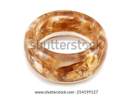 Baltic monolithic amber bracelet isolated on white - stock photo